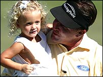 Phil Mickelson celebrates with his daughter Sophia