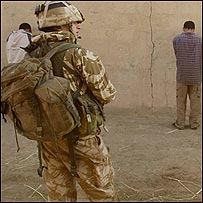 Black Watch soldier guarding detainees from Millionaires' Row