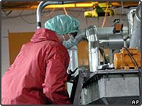 An worker at Iran's Isfahan nuclear, UCF, facility