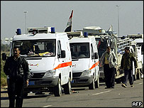 Iraqi Red Crescent convoy waits at entrance to Falluja, 24 Nov 2004