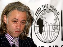 Bob Geldof with Band Aid logo