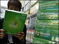 A man reads a label on a Microsoft software box