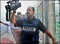 Bassam Masoud, Reuters cameraman, inured after explosion in Rafah, Gaza Stri