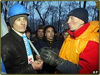 A supporter of opposition leader Viktor Yushchenko, right, appeals to a supporter of Prime Minister Viktor Yanukovych, in Ukraine's capital Kiev