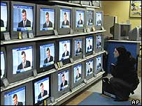 Woman watches presidential debate on TV on 15 November