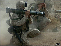 Marine firing into a building in Falluja. [Picture released by US Marines]