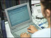 woman using computer keyboard