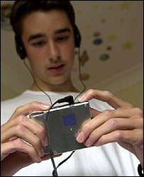 Photo of teenager using personal stereo