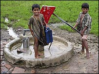 Two boys collect water from a contaminated well at Sunder Nagar, a colony in Bhopal. Copyright Rachna Dhingra