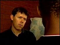 Barnaby Phillips talks to a teacher