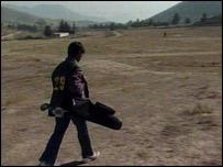 A young golf caddie in Kabul's golf club, Afghanistan