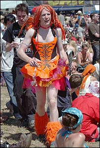 Flamboyantly dressed man in an orange tutu at the Glastonbury festival