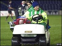 Paul Burke was stretchered off the field
