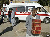 Iraqi Red Crescent ambulance and workers in Falluja