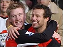 Paul Gallagher (left) celebrates scoring with Lucas Neill