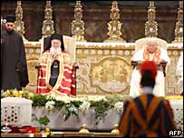 Pope John Paul II and Ecumenical Patriarch Bartholomew I sit in front of the relics