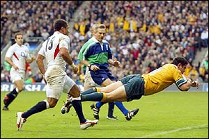 Australia's Jeremy Paul dives to score a try