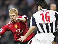 West Brom's Cosmin Contra (right) challanges Paul Scholes