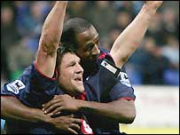 Arjan de Zeeuw (left) celebrates scoring with Ricardo Fuller