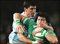 Ireland's Shane Horgan is well shackled by  Federico Aramburu