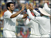 India bowler Zaheer Khan is congratulated by his team-mates
