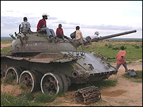Angolan children play on a wrecked tank