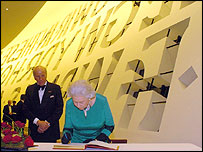 The Queen signs the visitors' book at the Royal Gala concert