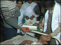 A doctor treating a man affected by the gas leak