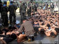 Thai police arresting Muslim protestors in Takbai