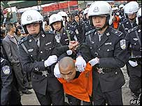 Police parade thief before he was to be executed, south-western city of Chongqing, 17 November 2004
