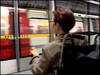 Photo of wheelchair user on tube platform