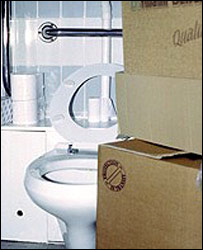 Photo of disabled toilet containing boxes