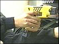 British firearms officers in a demonstration of the Taser gun
