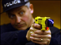 British firearms officer in a demonstration of the taser gun