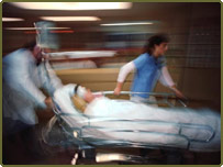 A trauma team rush a patient to treatment