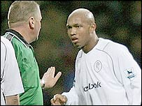 El-Hadji Diouf (right) is spoken to by the referee