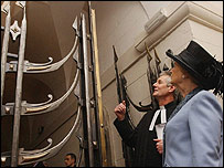 Baroness Thatcher with Canon Phillip Buckler at Churchill gates