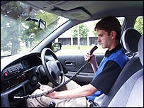 Driver about to blow into alcolock breathalyser