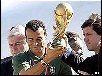 Brazil's victorious captain Cafu holds the World Cup trophy in 2002