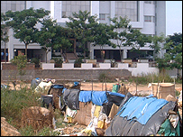 Workers' tents beside an office complex under construction