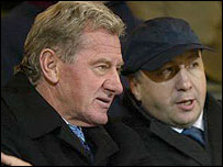 Velimir Zajec (right) watches the game with Milan Mandaric