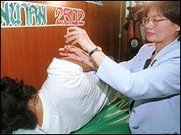 A volunteer receives a vaccine shot in Bangkok