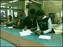 Women check their marital status a registry office