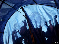 Displaced Sudanese children play outside a UN tent in a refugee camp, northern Darfur