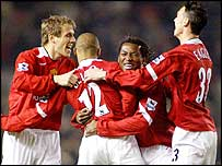 Man Utd celebrate David Bellion's goal