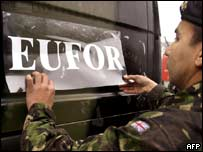 British soldier affixes new Eufor sticker to his vehicle