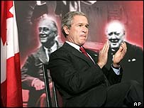 President Bush flanked by images of Franklin Roosevelt and Winston Churchill