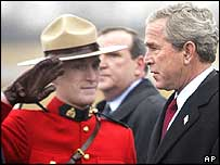 A Canadian 'Mountie' salutes Mr Bush
