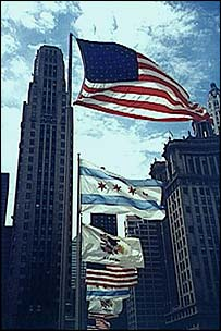 US flag flying amidst Chicago skyscrapers
