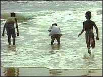 Children play in the sea